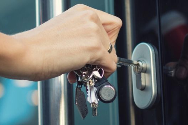 A woman locking a shop door